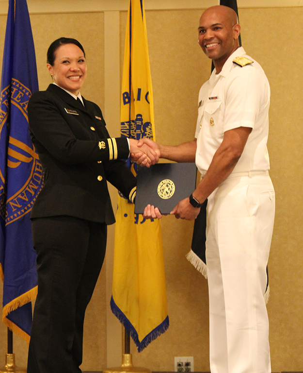 LT Rosario receiving her USPHS graduation certificate from U.S. Surgeon General Jerome Adams